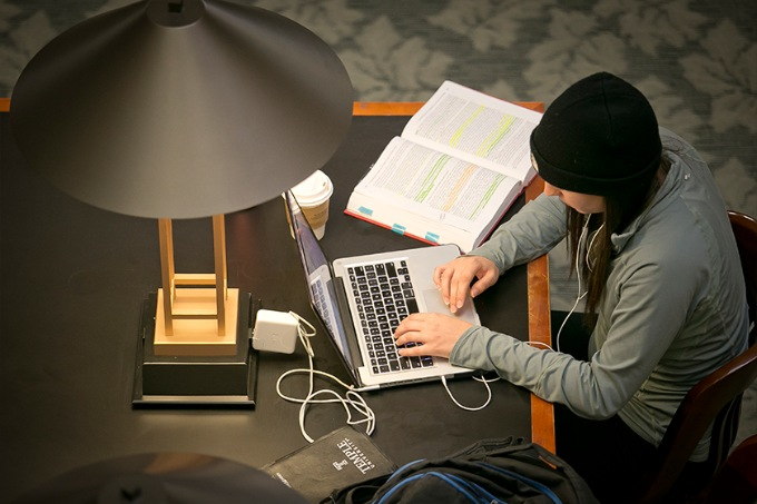 law student working on laptop